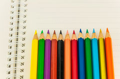 Pencils on note book Royalty Free Stock Photography