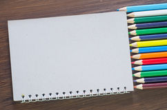Pencils and note Royalty Free Stock Photography