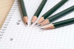 Pencils and notebook Stock Images