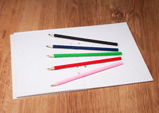 Pencils and notebook Stock Image
