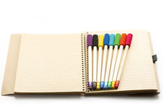 Pencils on notebook Stock Photography