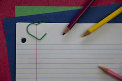 Pencils on notebook paper Stock Photo