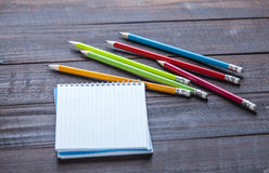 Pencils and notebook Stock Photography
