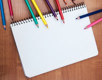 Pencils and notebooks Stock Image