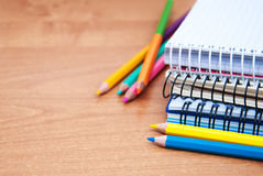 Pencils and notebooks Stock Photography