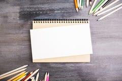 Pencils and notepad Stock Photos