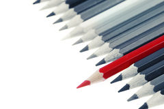 Pencils. One red pencil standing out from others royalty free stock photo