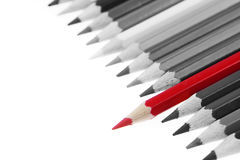 Pencils. One red pencil standing out from others royalty free stock photos