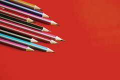 Pencils on an red background stock images