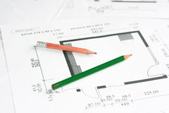 Pencils over blueprints Royalty Free Stock Photography