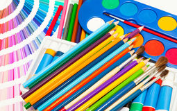 Pencils, paint and color chart of all colors Stock Photos