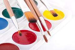 Pencils, paints and brushes on a white Royalty Free Stock Image