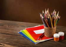 Pencils, paints and brushes. Stock Image