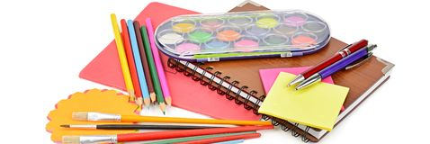 Pencils, paints, notebooks and other stationery isolated on a white background. Wide photo. Colored pencils, paints, notebooks and other stationery isolated on stock image