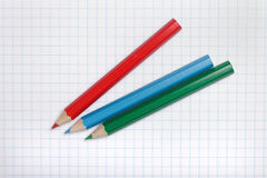 Pencils on paper. Royalty Free Stock Image