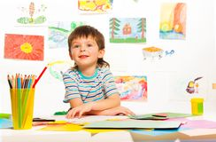 Pencils and paper for boy Stock Photography