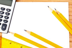Pencils, paper, calculator and ruler Stock Photo