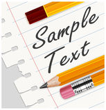 Pencils & paper in line with text Stock Photo