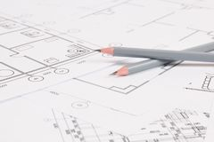 Pencils and paper ?ngineering house drawings and blueprints. Two pencils and some paper engineering house drawings and blueprints royalty free stock photos