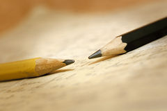 Pencils on paper Royalty Free Stock Images