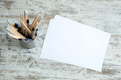 Pencils and paper on a wooden Desktop Stock Photo