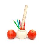 Pencils, pen, ruler and apple Stock Image