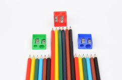 Pencils and pencil sharpeners. Colored pencils and sharpener on a  light background Royalty Free Stock Images