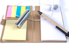 Pencils, pens, paperweights, put on your desk, on a white backg Stock Images