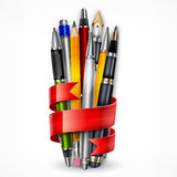 Pencils and pens with ribbon Stock Photos