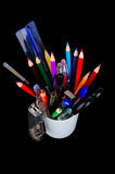 Pencils, pens, ruler, brush in a glass Royalty Free Stock Photo