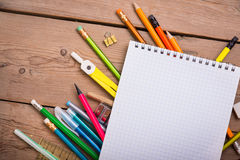 Pencils and pens student with a notebook Royalty Free Stock Image