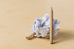 Pencils with a piece of crumpled paper Royalty Free Stock Photos