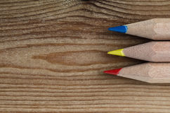 Pencils in Primary Colours on Wood Royalty Free Stock Photography