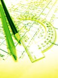 Pencils, protractor and drawings stock image