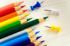 Pencils and Pushpins. Colourful Pencils and Pushpins on a Wooden Background Stock Image