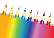 Pencils in a rainbow box. Set of rainbow colored pencils in a multicolored box isolated over white Royalty Free Stock Images
