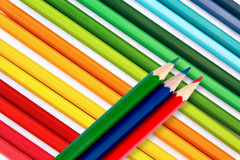Pencils in red, green blue. Colorful crayons on others as background Stock Photo