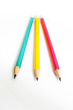 Pencils Red Yellow Green , Three Pencils on white background , Pencils, shallow depth. Pencils Red Yellow Green and note Royalty Free Stock Photo