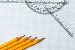 Pencils and rule. Pencils, rule,protractor and set square on graph paper Stock Photography