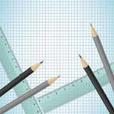 Pencils and rulers on checked paper Royalty Free Stock Image
