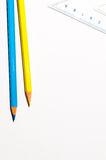 Pencils And A Ruller Over White Paper Royalty Free Stock Image