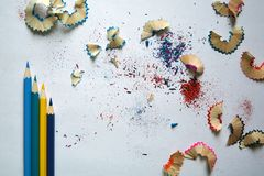 Pencils and sawdust on white background. royalty free stock image