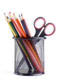 Pencils and scissors in the container. Isolated on the white Stock Photo