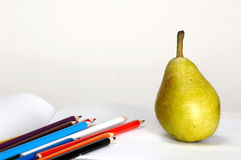 Pencils-set And Pear Royalty Free Stock Images