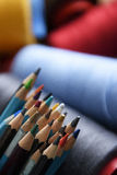 Pencils and sewing rolls Royalty Free Stock Photos