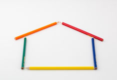 Pencils in the shape of a house. Frame of pencils in the shape of a house, on blank background Stock Photos
