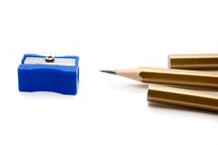 Pencils and shapner. On white background stock image