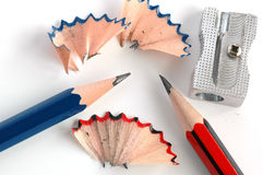 Pencils and sharpener. Two pencils and a sharpener depicting the situation of sharpening pencils Stock Photo