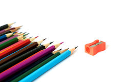 Pencils and sharpener. Royalty Free Stock Photos