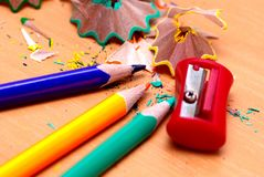 Pencils with a sharpener and shaving Royalty Free Stock Photo